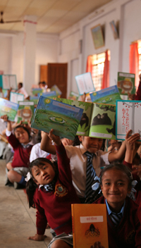 image:Children receiving donated picture books in India