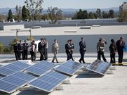 After the ceremony, participants went up onto the rooftop to observe the solar power generation system in action.