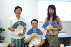 image:China: Folding fans provided to participants in the event by lottery