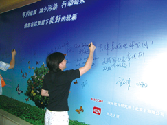 image:China: Participants writing their environmental messages on a board